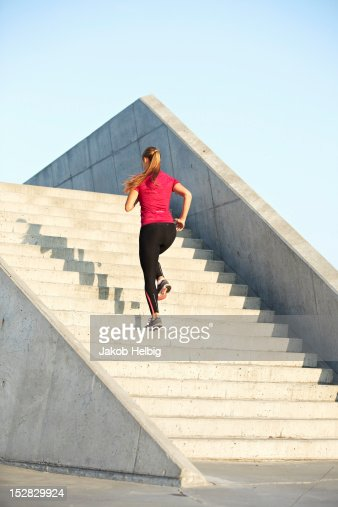 Woman running on staircase