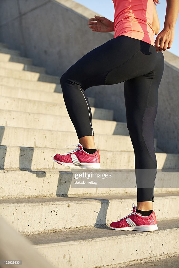 Woman running on staircase : Stock Photo