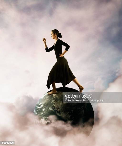 Woman running on top of globe
