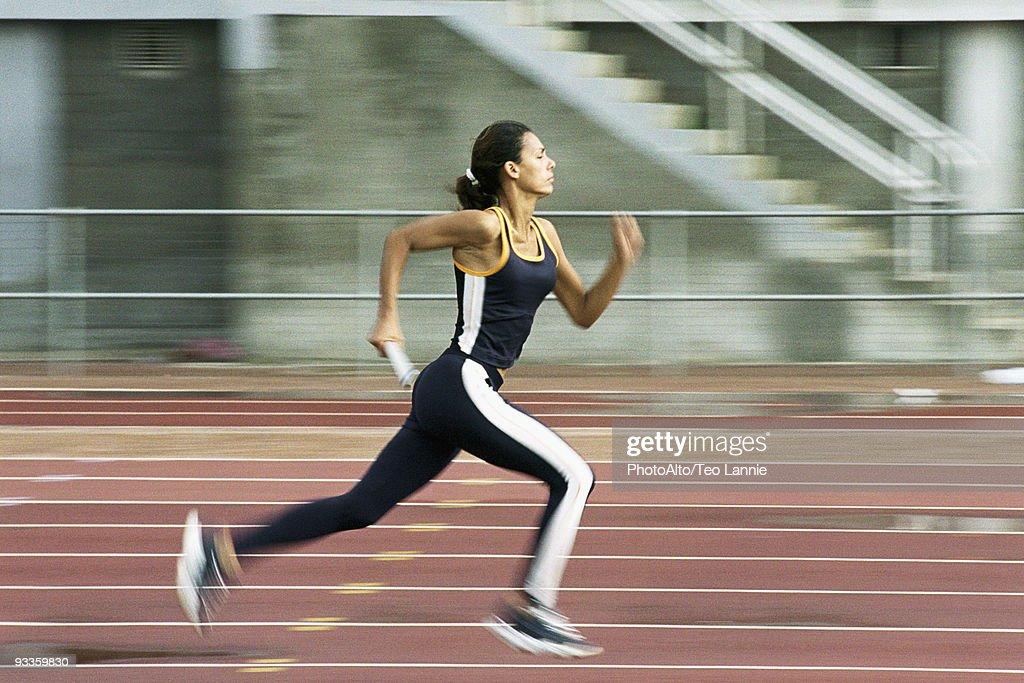Woman running on track : Stock Photo