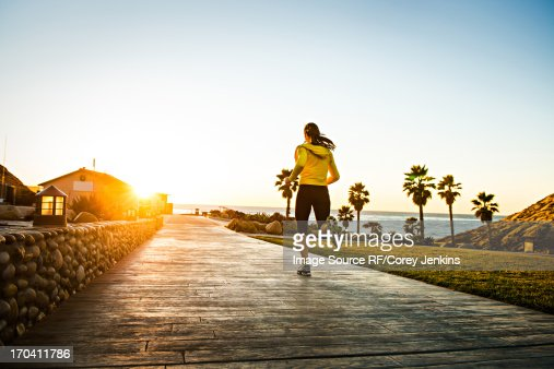 Woman running on wooden path : Stock Photo