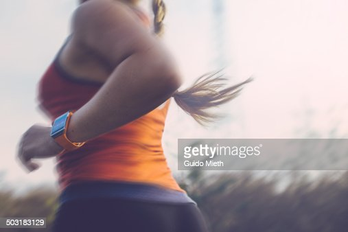 Woman running outdoor.