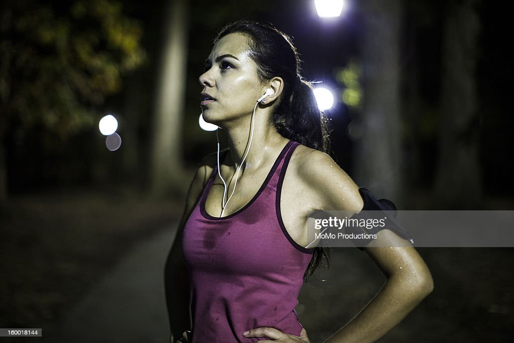 Woman running outdoors, nighttime