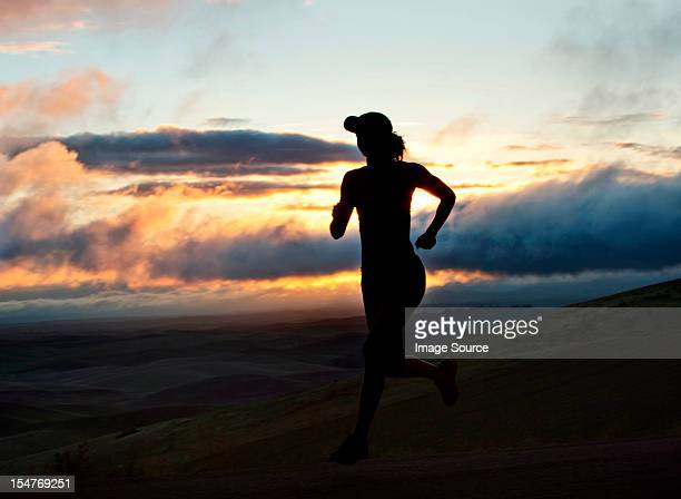 Woman running outside, silhouette