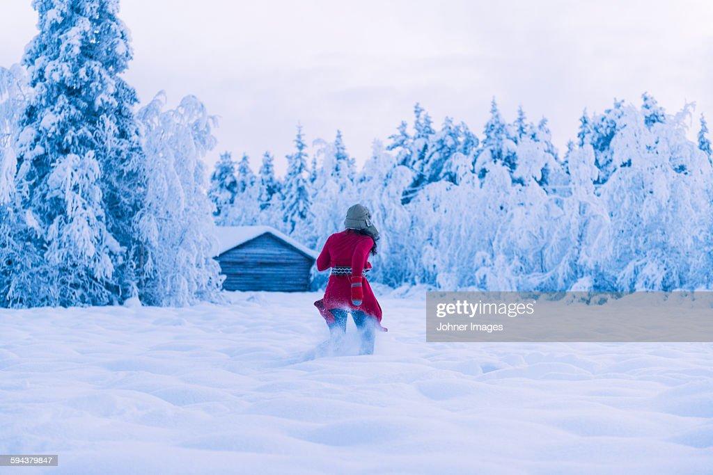 Woman running through snow