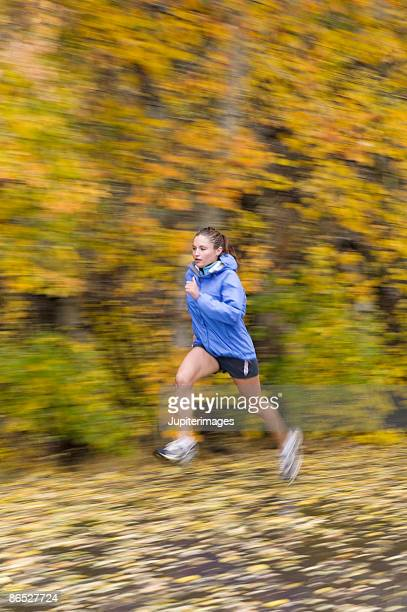 Woman running through woods