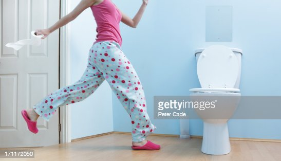 Woman running to toilet in night clothes