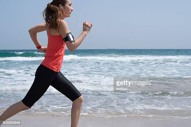 Woman running toward the goal