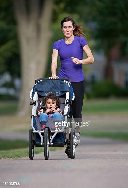 Woman running while pushing baby in stroller