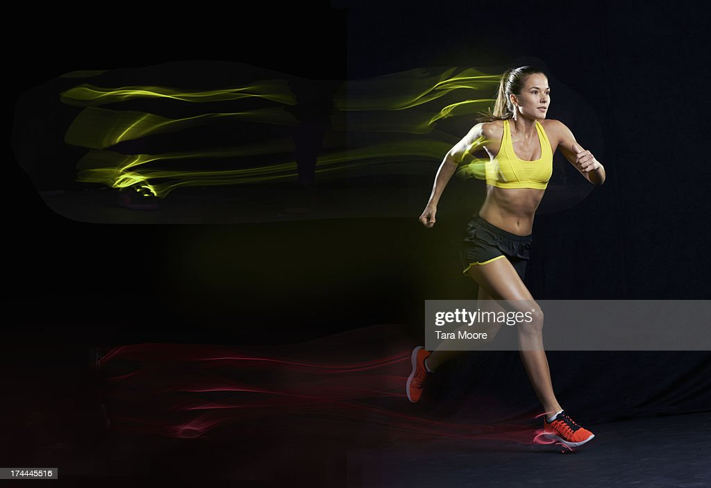 woman running with light trails : Stock Photo
