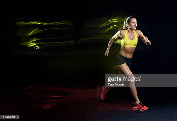 woman running with light trails