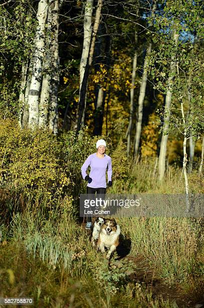 Woman running with two dogs