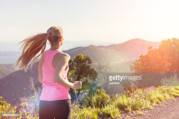 Woman running/sprinting outdoors