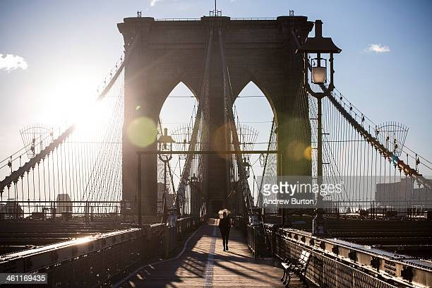 A woman runs across the Brooklyn Bridge despite the cold on the morning of January 7 2014 in New York United States A polar vortex has descended on...