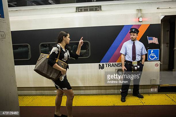 A woman rushes to catch the NJ Transit train from New York Penn Station to Trenton NJ on May 13 2015 in New York City An Amtrak train crash in...