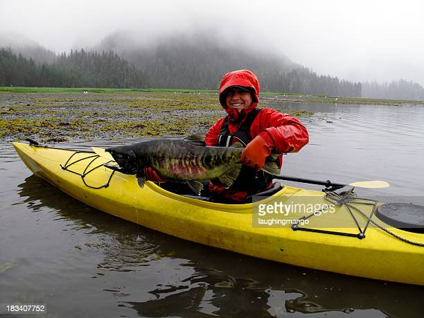 woman salmon kayak alaska
