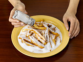 Woman Salting Junk Food