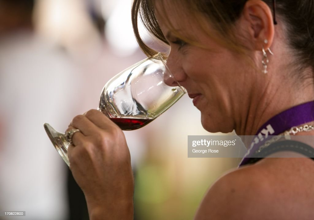 A woman samples a taste of wine during the Aspen Food Wine Classic Grand Tastings on June 14 in Aspen Colorado The 31st Annual Food Wine Classic...