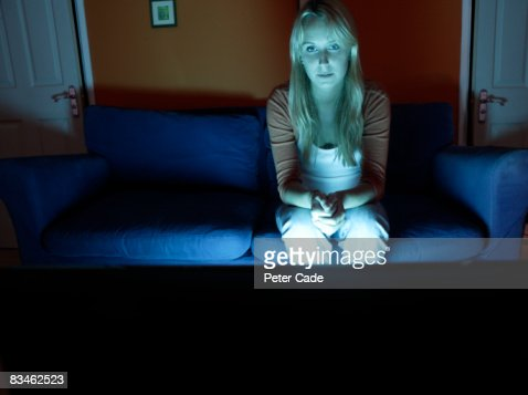woman sat alone watching television : Stock Photo