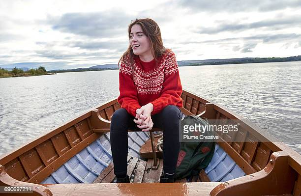 Woman sat in a row boat