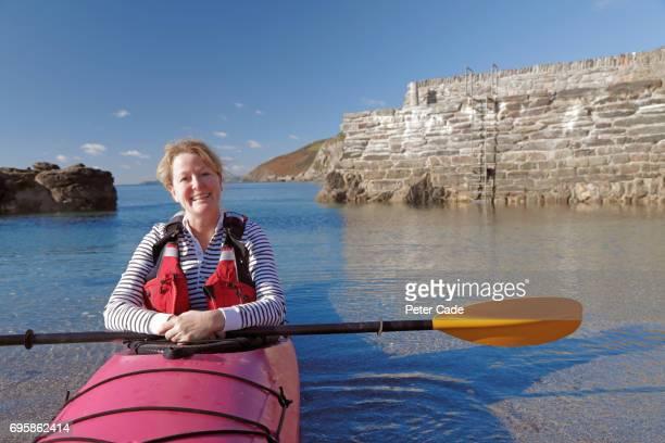 Woman sat in kayak in the sea