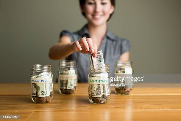 Woman saving in jars