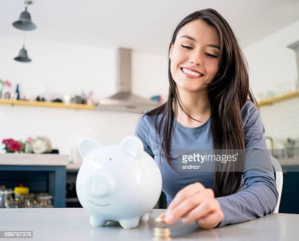 Woman saving woman in a piggybank