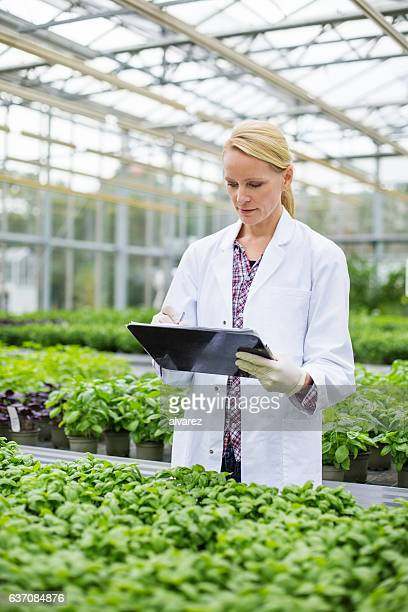 Woman scientist working in garden center