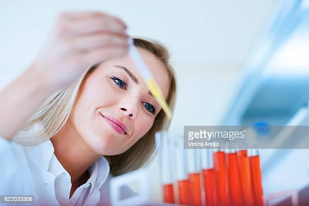 Woman scientist working in laboratory