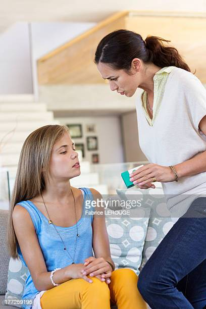 Woman scolding her daughter at home