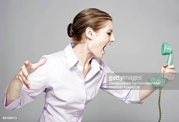Woman screaming in to the phone