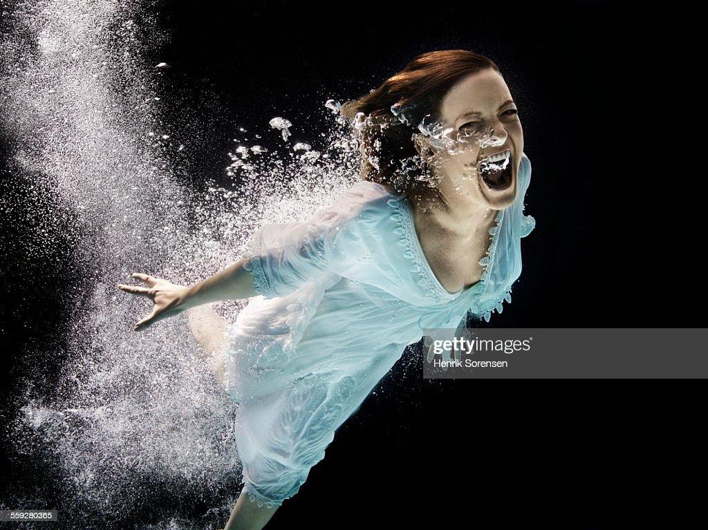 woman screaming under water