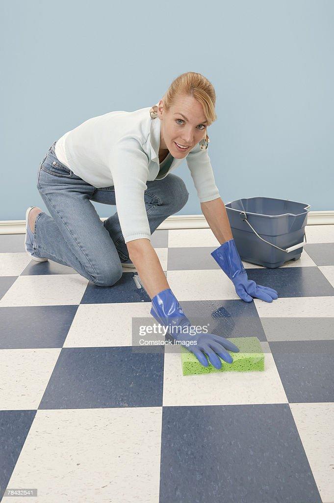 Woman scrubbing floor : Stock Photo