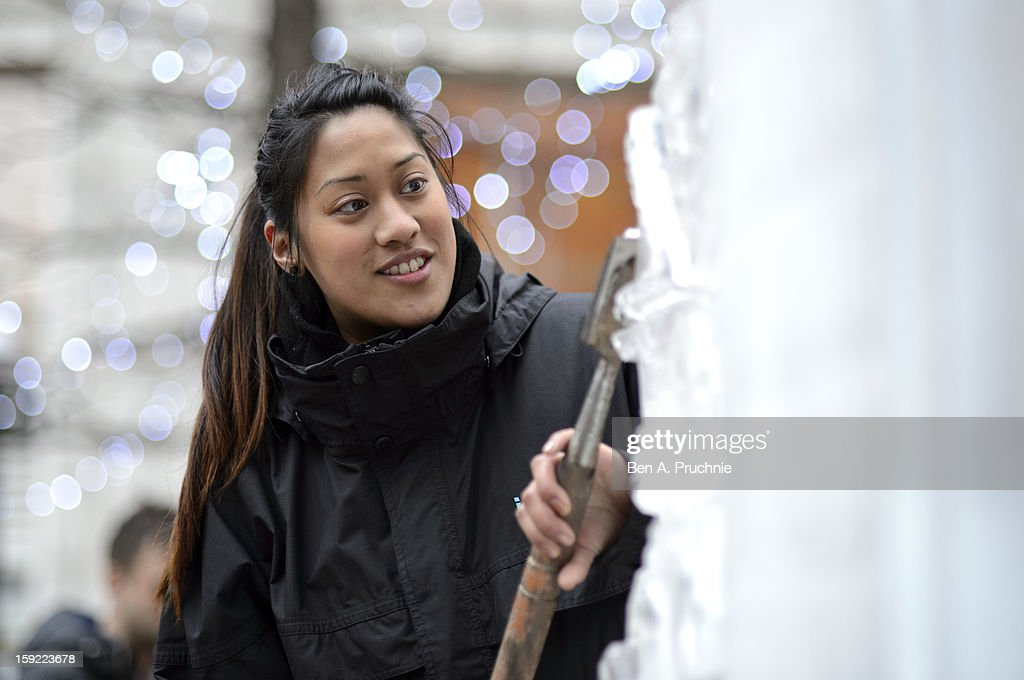 A woman sculpts ice as the London Ice Sculpting festival is launched on January 10, 2013 in London, England.