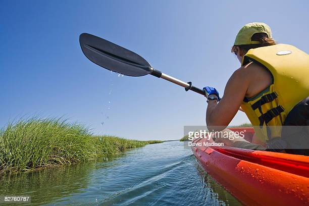 Woman sea kayaking in Cape Cod