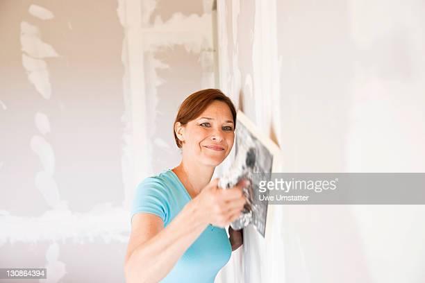 Woman sealing a wall