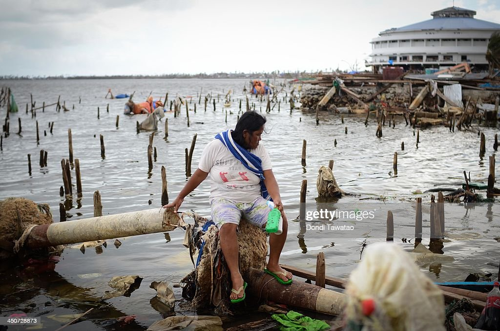 A woman searches for usable materials on November 20 2013 in Tacloban Leyte Philippines Typhoon Haiyan which ripped through the Philippines on...