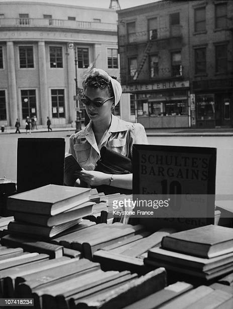 Woman Searching A Book On A Bookstall