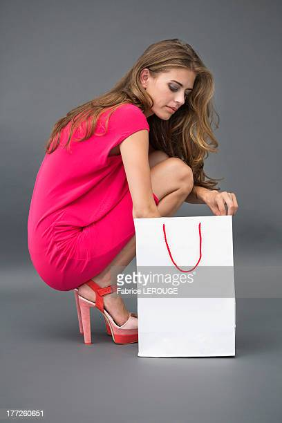 Woman searching into a shopping bag