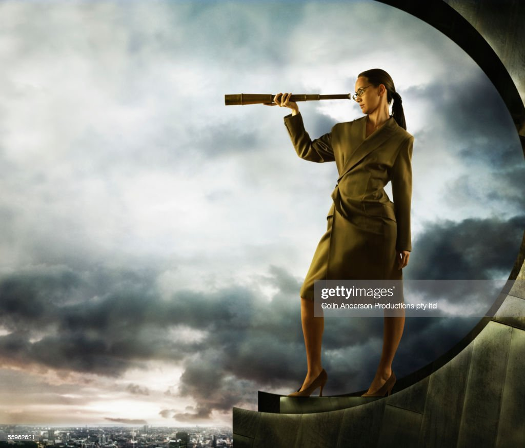 Woman searching with telescope : Stock Photo
