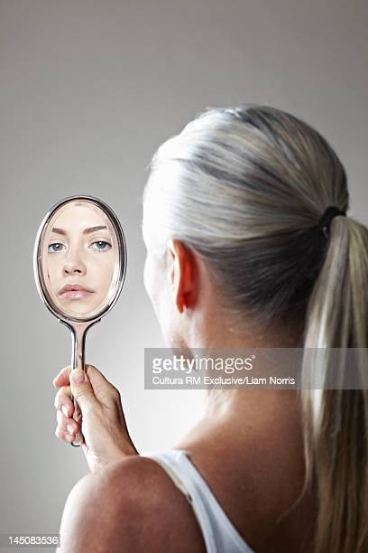 Woman seeing herself younger in mirror