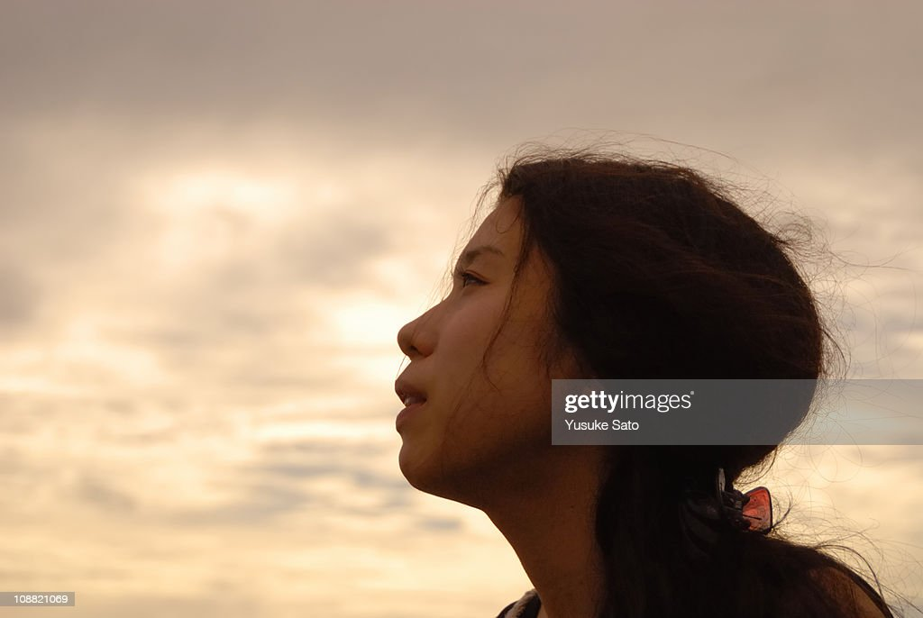 Woman seeing the sky of sunset