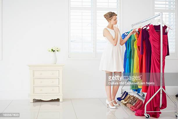 Woman selecting clothes in bedroom