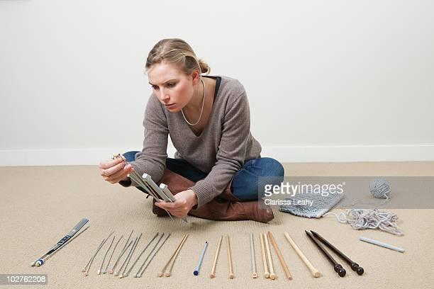 Woman selecting knitting needles