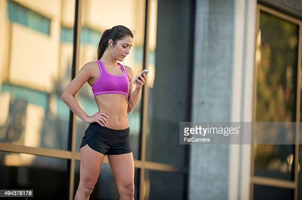 Woman Selecting Music for Her Run