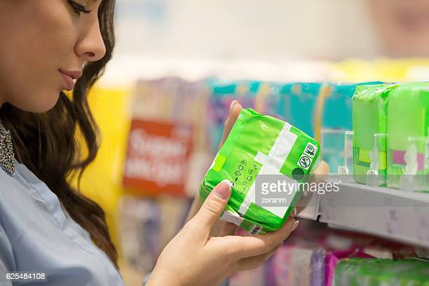 Woman selecting pad