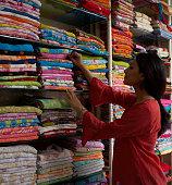 Woman selecting sari in sari shop