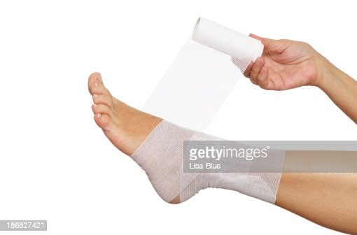 Woman Self Bandaging Ankle