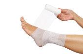 Woman Self Bandaging Ankle