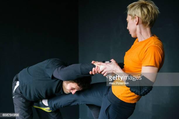 Woman self-defense trick against the man's attack. Strong women practicing self-defense martial art Krav Maga